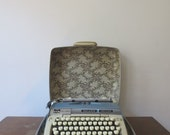 Vintage Blue Smith Corona Galaxie Deluxe Typewriter in Floral Hard Case