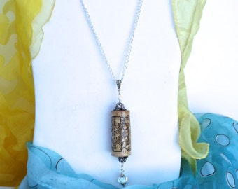 CELEBRATE, an Up-cycled Wine Cork Necklace, created with a recycled wine cork, sealed and embellished, symbolizing the Celebration of Life