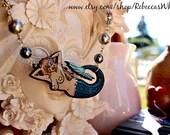 Mermaid with swarovski pearls and crystals.