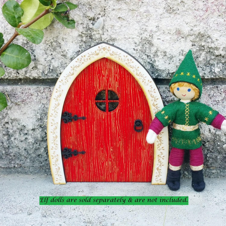 Elf door red christmas elf door kindness tradition for Red elf door