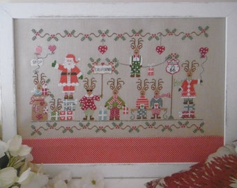 Natale On The Road cross stitch pattern by Cuore e Batticuore at cottageneedle.com December Winter holidays Santa Claus reindeer snow