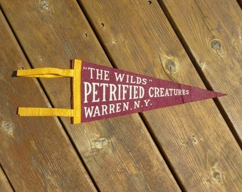 Petrified Creatures The Wilds Warren NY Felt Pennant