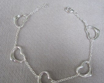 Five Silver Open Hearts Linked Together Bracelet