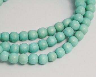 6mm Seafoam Green Wood Beads -16 inch strand