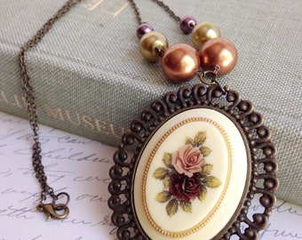 Cameo necklace, statement necklace, Vintage floral cameo, pearls and crystals. Boho, bohemian, fall fashion, autumn, flower jewelry