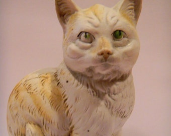 """Older Bisque Porcelain cat figurine.most likely Germany..marked """"4754""""..sweet old kitty"""