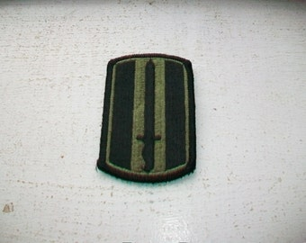 US Army Sword Patch Green and Black New Old Stock