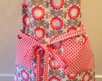 Chef style apron in a KOKO Lee print in gray, coral pinks, and white print