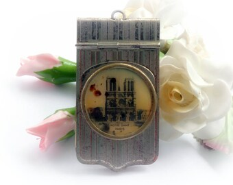 Antique French Carnet de Bal, Aide de Memoir Dance card with a picture of the Notre Dame Cathedral, rust and wear present