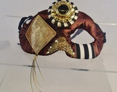 Creature from the Nile Masquerade Mask Steampunk Feather Accented Gold Black White Brown Half Face Asymetrical Fabric Burlesque Halloween