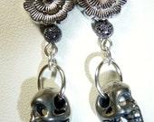 Silver skull with silver flower earrings