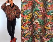 Vintage 80s Heavily Embroidered rainbow Bright SKEA Black Satin Ski Bomber Jacket w/ Dolman Sleeves. Avant garde boho glam winter coat Small