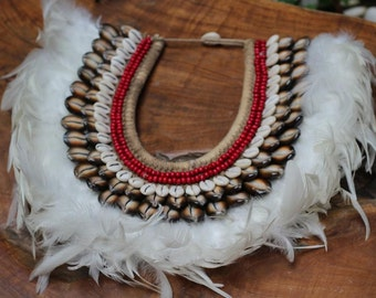 Papua Native Warrior necklace with white feathers and brown , white  shells.