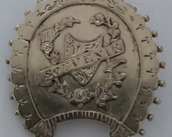 Vintage engraved souvenir brooch