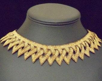 Golden chevron collar
