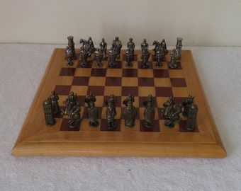 magnificent vintage chess set antique theme beautiful intricate metal pieces wooden playing board