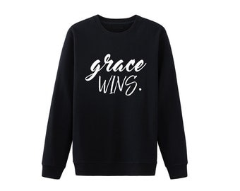 Grace wins Christian shirt. Grace shirts. Christian sweatshirt. Christian shirts for men. Christian shirts for women. Christian shirts.