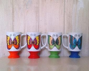 Set of 4 Arnart 5th Avenue LA BUTTERFLY Rainbow Pedestal Mugs - Blue Red Orange Green