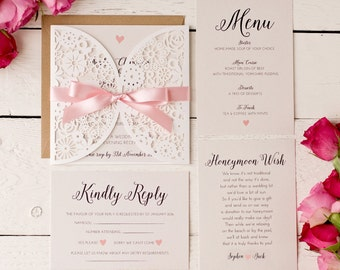 Pearlescent intricately laser cut floral wedding invitation sample