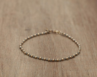 Adorable delicate gold filled beads and knotted silk thread bracelet with tag. Simple women