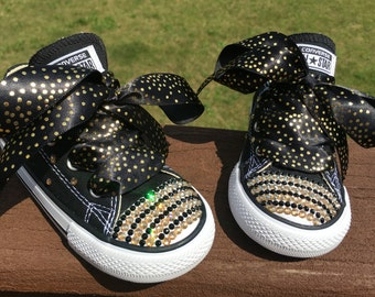 Get your gold!   Converse loaded with black and gold Swarovski crystals.  New!  Just in