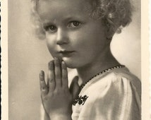 Little prayer, sweet girl with blonde curls and embroidered smock, deckled edge postcard c1940s, supply ephemera