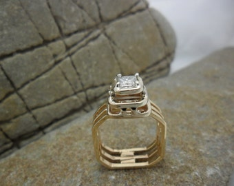 14K gold ring set with a princess cut diamond