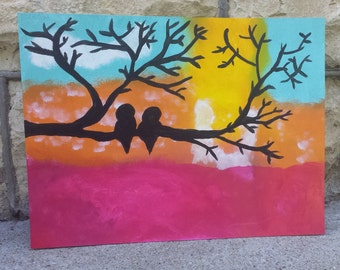 Birds in a tree on a sunset
