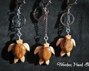 Animal keychain handmade with solid wood; metal chain;