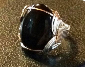 Nice Gents ring of sterling silver is a sardonyx in onyx stone could be unisex.  Traditional Pharoah Ring styling.  Size 11.