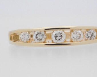 0.33 Carat T.W. Ladies Round Cut Diamond Band 14K Yellow Gold Ring