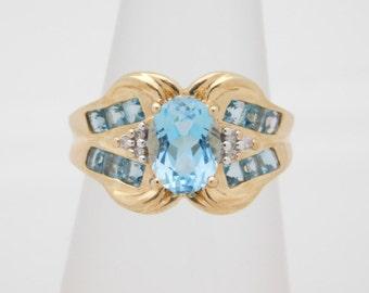 Ladies Oval Blue Topaz & Round Diamond Ring 14K Yellow Gold