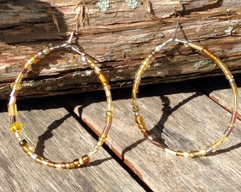 Beaded hoops in brown and gold tones.  Seed and glass beads throughout.  Inspired by Sundance.
