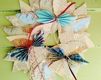 Paper Butterflies and vintage encyclopedia paper and map leaves wreath. White/cream with blue butterflies.