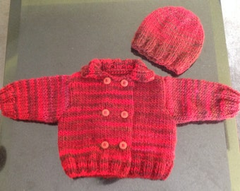 Hand knitted baby jacket/sweater and hat, size 3 months in the shades red and burgondy