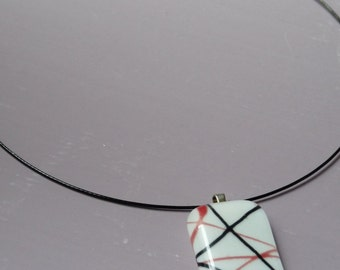 Glass Necklace - White glass pendant with red & black lines, on a black steel necklet