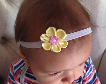 Satin flower baby headband.