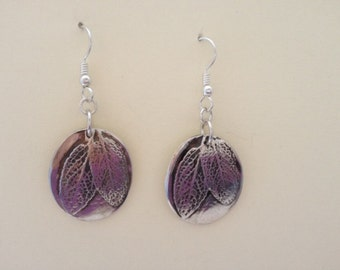 Silver oval sage leaf dangle earrings.