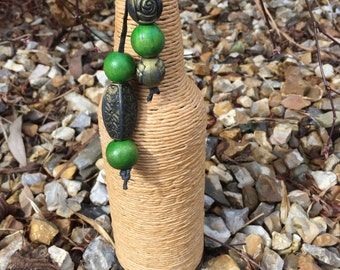Twine covered bottle with beads