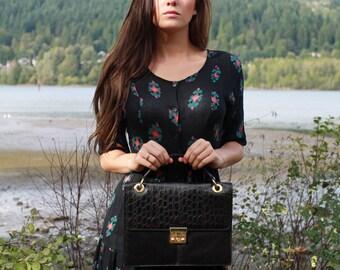 Vintage 80s top handle black embossed leather handbag
