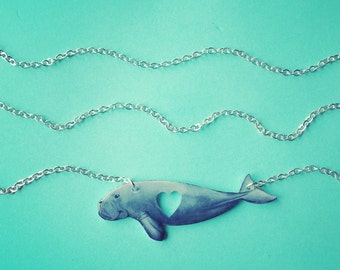 Dugong necklace. Sirenian glossy charm pendant with cut-out heart, 19 inch faux silver chain. Perfect Marine Biology gift for any sea lover.