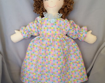 Old fashioned 15 inch cloth doll with blue or brown eyes and light brown hair comes with multi-colored nightgown