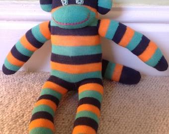Eddie the green and orange striped sock monkey