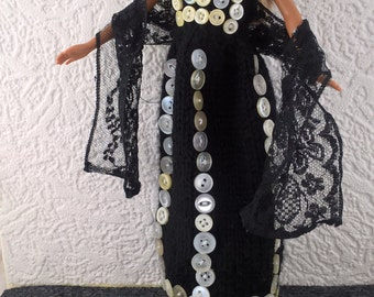 Long black Barbie dress decorated with pearly buttons and a lace shawl sprinkled with small pearl beads.Hand knit ballgown for fashion doll.