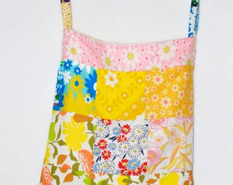 fabric  patchwork shoulder bag the strap is adjustable and is long enough to also be worn acoss your body