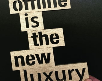 Offline is the new luxury - wood lettering