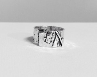 Abstract Strength Silver Ring