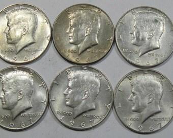 You get nine coins all 1967 silver Kennedy half dollar coin (E127a)