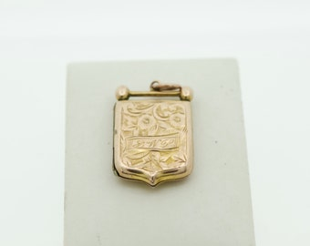 An unusual Vintage 9ct Gold BK&FT locket
