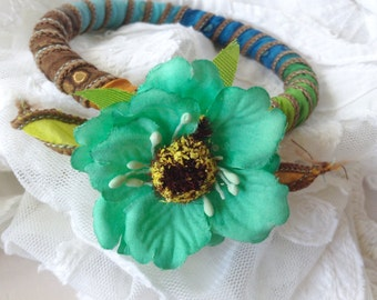Silk wrapped bangle with silk flower embellishment